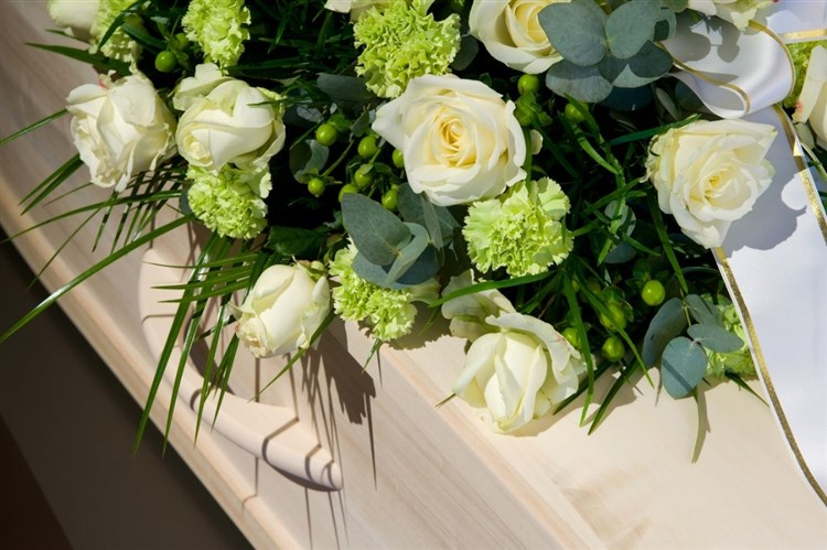 Funeral flowers on coffin